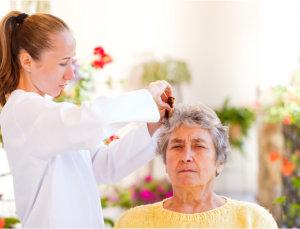 caregiver combing patient's hair